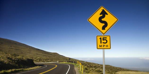 Curvy road sign in Haleakala National Park, Maui, Hawaii.