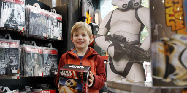 PARIS, FRANCE - NOVEMBER 04:  A kid shows a box of Sphero BB-8 Star Wars droid for sale at La Grande Recre' store on November 4, 2015 in Paris, France. The merchandise is on sale ahead of the December 16 release of the 'Star Wars Episode VII : The Force Awakens' in Paris.  (Photo by Chesnot/Getty Images)