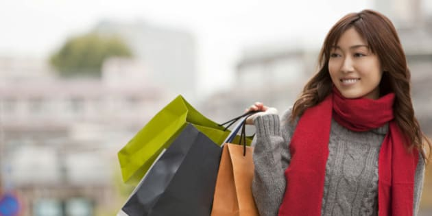 Young woman shopping on street