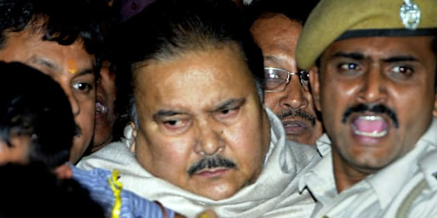 KOLKATA, INDIA - DECEMBER 13: Madan Mitra, West Bengal Transport Minister (Trinamool Congress) being taken to the Alipore court from the CBI office, at Saltlake on December 13, 2014 in Kolkata, India. He has been arrested in connection with the multi-crore Saradha chit fund scam. Thousands of investors allegedly lost over INR 200-300 billion when Saradha chit fund group collapsed in April 2013. (Photo By Subhendu Ghosh/Hindustan Times via Getty Images)