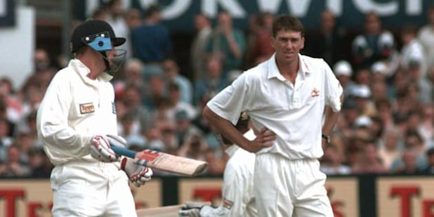 Australia's Glenn McGrath watches as England's Captain Michael Atherton, left, adds runs to England's score during morning play in the second day of the fourth test match at Headingley, Leeds Friday July 25 1997.(AP Photo/Rui Vieira)