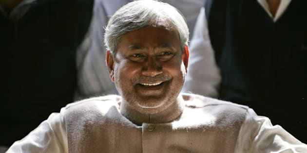 Janata Dal (United) leader Nitish Kumar smiles at press conference after the National Democratic Alliance won the majority of seats in the Bihar state elections, in New Delhi, India, Tuesday, Nov.  22, 2005. Kumar, would-be chief minister of Bihar Tuesday indentifed good governance as his foremost task, according to news agency reports. (AP Photo/Saurabh Das)