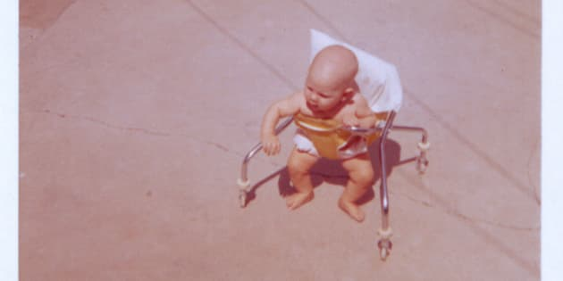 Child in baby walker, circa. 1960s.