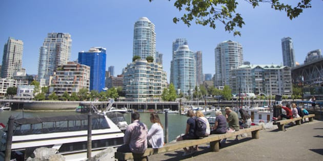 Granville Island market, people resting on beaches with condo towers background.