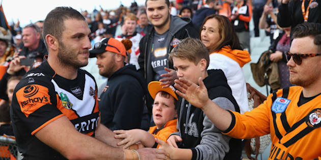 SYDNEY, AUSTRALIA - AUGUST 30:  Robbie Farah of the Wests Tigers high fives the crowd after the Tigers last home game of the season during the round 25 NRL match between the Wests Tigers and the New Zealand Warriors at Campbelltown Sports Stadium on August 30, 2015 in Sydney, Australia.  (Photo by Mark Kolbe/Getty Images)