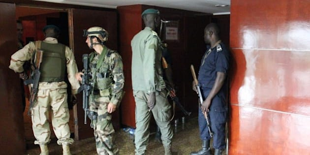 Malian soldiers and special forces stand guard at the entrance the Radisson Blu hotel in Bamako on November 20, 2015, after the assault of security forces. Malian forces backed by French troops stormed the Radisson Blu hotel in the capital Bamako after suspected Islamist gunmen seized guests and staff in a nine-hour hostage crisis that left at least 18 people dead. UN Secretary-General Ban Ki-moon condemned the 'horrific terrorist attack' on November 20, and indicated the violence was aimed at destroying peace efforts in the country. AFP PHOTO / HABIBOU KOUYATE        (Photo credit should read HABIBOU KOUYATE/AFP/Getty Images)