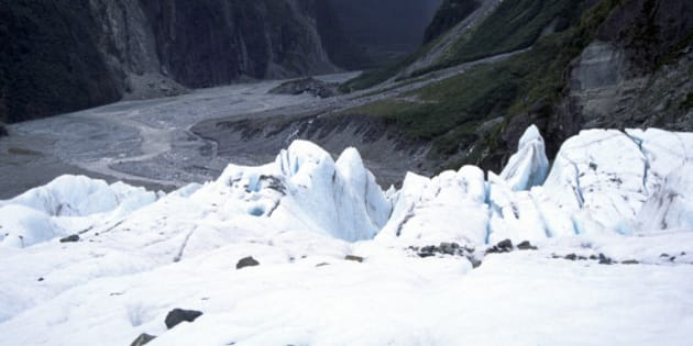 View down the U shaped glacial trough from near the front of the Fox glacier, New Zealand (Photo by: Geography Photos/Universal Images Group via Getty Images)