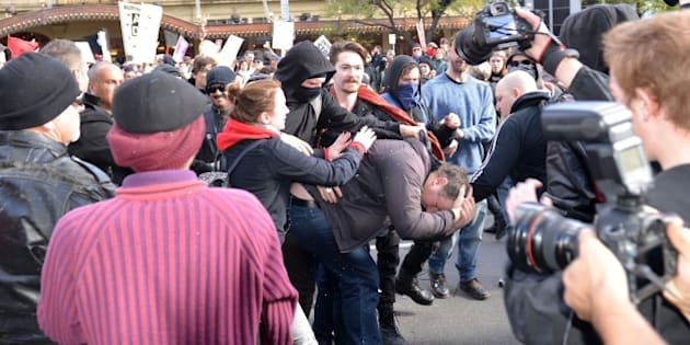 MELBOURNE, AUSTRALIA - JULY 18: Anti-racism activists and anti-Islam protesters clash in Melbourne, Australia on July 18, 2015. Hundreds of police were deployed in Western Australia on Saturday to break up violent protests near Parliament House in Melbourne after demonstrators from a right wing anti-Islam group faced off against anti-racism groups. (Photo by Recep Sakar/Anadolu Agency/Getty Images)