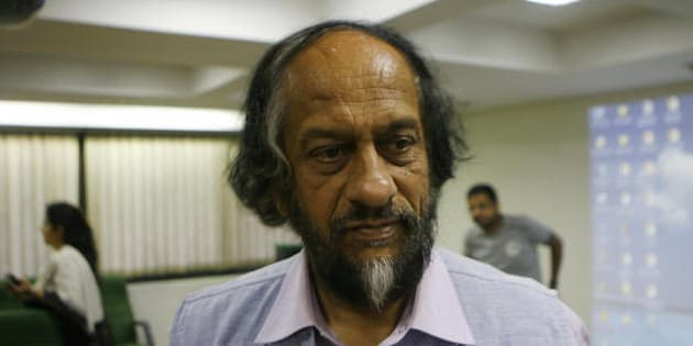 Director-General, TERI and Chairman, Intergovernmental Panel on Climate Change R.K. Pachauri chats with journalists after a press conference in New Delhi on July 8, 2008, on opportunities and implications Related to India's National Action Plan on Climate Change (NAPCC). The NAPCC was unveiled on June 30, demonstrating India's commitment to meeting the challenges of climate change,  NAPCC signals India's intent to move towards greater use of renewable energy resources and more efficient managemnet of critical natural resources such as water.  AFP PHOTO/ Manpreet ROMANA (Photo credit should read MANPREET ROMANA/AFP/Getty Images)