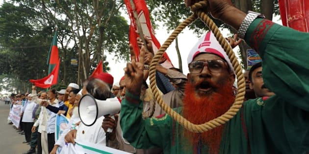 Bangladeshi secular activists and former fighters who fought in the 1971 war of independence against Pakistan protest as they call for the death penalty to be upheld for opposition leaders for Salauddin Quader Chowdhury and Ali Ahsan Mohammad Mujahid, over war crimes in that conflict, outside the Supreme Court in Dhaka on November 18, 2015. Bangladesh's highest court on November 18 upheld the death sentences of two opposition leaders convicted for atrocities during the 1971 independence war against Pakistan, sparking fears of violence by their supporters.  AFP PHOTO        (Photo credit should read STR/AFP/Getty Images)