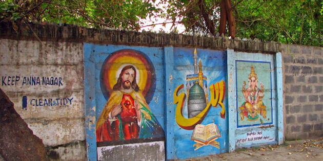 This picture neatly captures the appropriation of public space and walls by permanently painted images one can find everywhere in Chennai. 