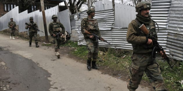 SRINAGAR, INDIA - APRIL 2: Army soldiers carry out a search operation for suspected militants during a gunbattle at Hardshoora village on April 2, 2015 some 35 kilometers (20 miles) north of Srinagar, India. Suspected terrorists killed two security personnel and wounded two soldiers and a civilian in a fierce gunbattle. (Photo by Waseem Andrabi/Hindustan Times via Getty Images)