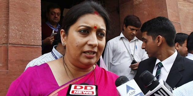 NEW DELHI, INDIA - FEBRUARY 28: HRD Minister Smriti Irani talks with media during the Budget session at the Parliament House on February 28, 2015 in New Delhi, India. Union Finance Minister Arun Jaitley promised higher investment in India's decrepit roads and railways, offered the carrot of corporate tax cuts to global corporations and the stick of tighter compliance rules to get Indian tycoons to invest at home rather than stash wealth abroad. He forecast inflation at 5% by the end of the fiscal year ending March 2016, undershooting the Reserve Bank of India's 6% target and creating room to cut interest rates. Annual inflation was 5.1% in January. He proposed to abolish the wealth tax and proposed two percent surcharge on the super rich. He said the government is proposing to rationalise various tax exemptions and incentives to reduce tax disputes and improve tax administration. (Photo by Sanjeev Verma/Hindustan Times via Getty Images)