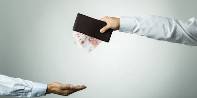 Businessman's hand holding wallet