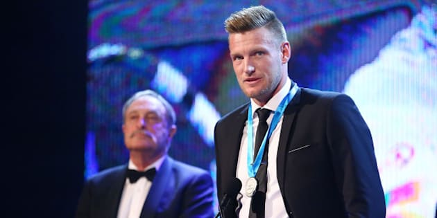 MELBOURNE, AUSTRALIA - NOVEMBER 23:  Sam Groth, winner of the Newcombe Medal speaks on stage as  John Newcombe looks on at the 2015 Newcombe Medal at Crown Palladium on November 23, 2015 in Melbourne, Australia.  (Photo by Scott Barbour/Getty Images)