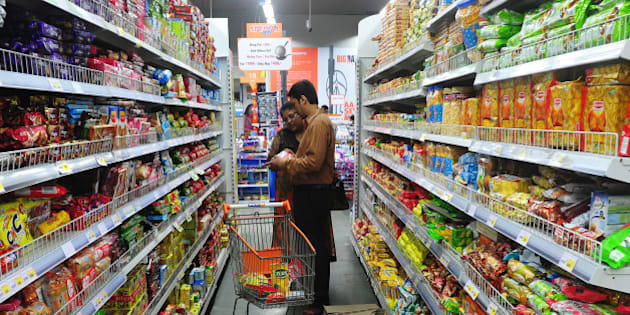 TO GO WITH: India-economy-retail-investment,update-FOCUS  An Indian family shops at the Big Bazaar supermarket in Mumbai on September 5, 2013.  A year since India reduced foreign investment barriers to its retail sector to spur flagging economic growth, confusing rules and political uncertainty are keeping overseas supermarket giants away, analysts say. AFP PHOTO/ Indranil MUKHERJEE        (Photo credit should read INDRANIL MUKHERJEE/AFP/Getty Images)