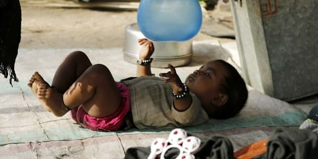 AJMER, INDIA - 2015/05/10: A baby playing  balloon on the occasion of 'Mothers Day'. (Photo by Anand Sharma/Pacific Press/LightRocket via Getty Images)