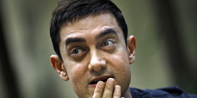 "Bollywood actor Aamir Khan gestures during a press conference to promote his new film ""Talaash,"" or Search, at his residence in Mumbai, India, Tuesday, Dec. 4, 2012. (AP Photo/Rafiq Maqbool)"