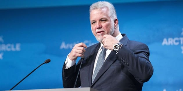 Quebec Premier Philippe Couillard delivers a speech during the opening plenary session of the Arctic Circle 2015 Assembly in Reykjavik on October 16, 2015. The conference draws attention to the damage caused by global warming, ahead of major UN talks on climate change in Paris this year.  AFP PHOTO / HALLDOR KOLBEINS        (Photo credit should read HALLDOR KOLBEINS/AFP/Getty Images)