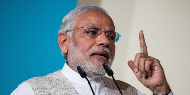 Narendra Modi, India's prime minister, gestures whilst speaking during the 37th Singapore Lecture held at the Shangri-La Hotel in Singapore, on Monday, Nov. 23, 2015. Modi's government, which in February pushed back its deadline for fiscal consolidation by a year to March 2018, faces a higher wage bill just as a sluggish economy and dwindling asset sales are weighing on revenue. Photographer: Nicky Loh/Bloomberg via Getty Images