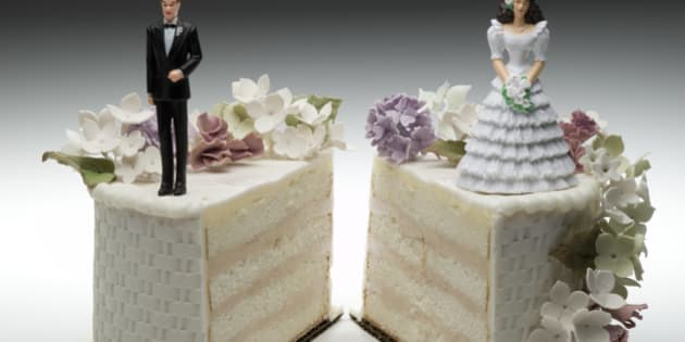 Bride and groom figurines standing on two separated slices of wedding cake