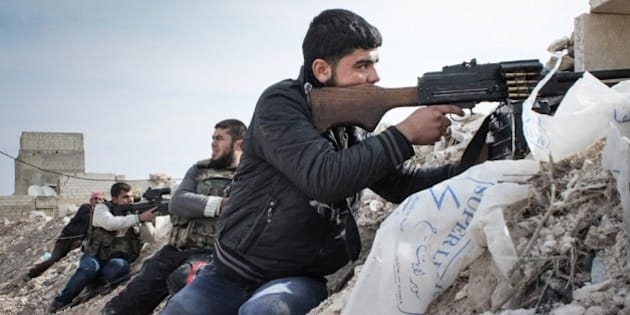 Free Syrian Army rebels take up positions along an embankment on the outskirts of the northwestern city of Maraat al-Numan, Syria. After months of fierce fighting for control of the vital Aleppo-Damascus highway, rebels have succeeded in pushing the Syrian army out of the center of Maraat al-Numan located on the highway between Aleppo and Hama. (AP Photo/Mustafa Karali)