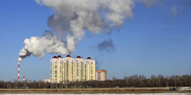 This picture taken on November 22, 2015 shows smoke belching from a heating factory chimney in Heihe, in northeastern China's Heilongjiang province. China is the world's biggest polluter, and its emissions of the greenhouse gases that cause climate change -- along with its ability to fulfill its promises -- will be at the centre of talks starting in Paris this month that are crucial to the future of the planet.       CHINA OUT    AFP PHOTO / AFP / STR        (Photo credit should read STR/AFP/Getty Images)