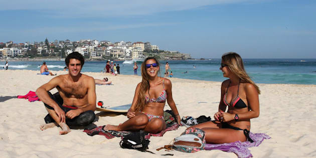 SYDNEY, AUSTRALIA - OCTOBER 31: Students from Latin America enjoy the warm weather down at Bondi Beach on October 31, 2014 in Sydney, Australia.  Australia is expecting much hotter temperatures than usual for the next three months.  (Photo by Daniel Munoz/Getty Images)