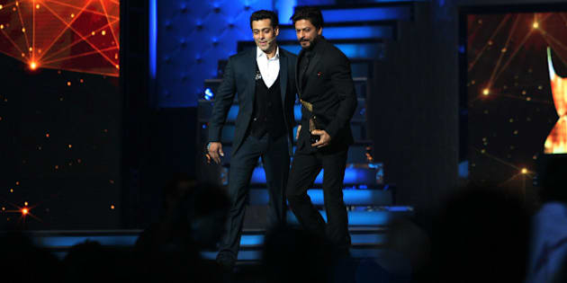 MUMBAI, INDIA -JANUARY 16: Bollywood actor Salman Khan and Shah Rukh Khan at the stage of Star Guild Awards in Mumbai.(Photo by Milind Shelte/India Today Group/Getty Images)