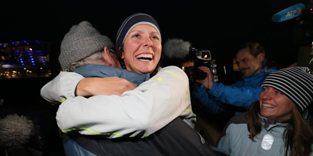 Quebec rower Mylene Paquette, center, is welcomed by her father, Jean, left, and her sister, Evelyne, right, as she arrives in Lorient, western France, Tuesday, Nov. 12, 2013, after a solo journey across the Atlantic Ocean. Paquette is the first North American woman to row solo across the North Atlantic. She left Halifax just over four months ago in a specially designed 7.3-metre boat propelled only by Paquette and the currents.(AP Photo/David Vincent)