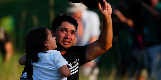 SHEBOYGAN, WI - AUGUST 16:  Jason Day of Australia walks off the 18th green with his son Dash after winning the 2015 PGA Championship with a score of 20-under par at Whistling Straits on August 16, 2015 in Sheboygan, Wisconsin.  (Photo by Kevin C. Cox/Getty Images)
