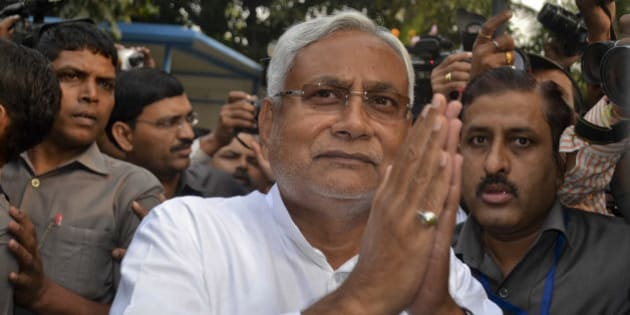 Bihar Chief Minister Nitish Kumar greets supporters after victory in Bihar state elections in Patna, India, Sunday, Nov. 8, 2015. The alliance led by Kumar defeated Indian Prime Minister Narendra Modi's ruling Hindu nationalist party in a crucial election in one of India's most populous states.(AP Photo/Aftab Alam Siddiqui)