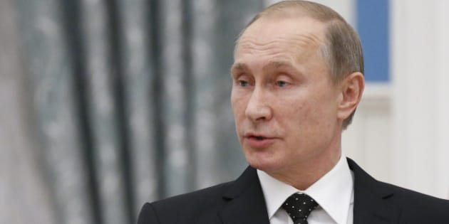 Russian President Vladimir Putin speaks at a news conference after the meeting with his French counterpart Francois Hollande, in Moscow, Russia, Thursday, Nov. 26, 2015. French President Francois Hollande is in Moscow on Thursday to push for a stronger coalition against Islamic State militants in Syria, trying to unite France, the U.S. and Russia. (AP Photo/Alexander Zemlianichenko, pool)