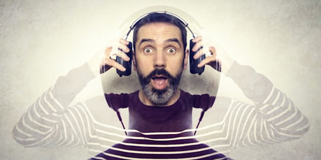 Double exposure of a man listening to music on his headphones.