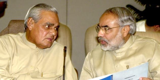Indian Prime Minister Atal Bihari Vajpayee, left, speaks with Gujarat Chief Minister Narendra Modi at the prime minister's residence in New Delhi Wednesday March 27, 2002. Police opened fire as Hindu mobs fought with residents in a Muslim section of Gujarat state's largest city on Tuesday, killing a Muslim as a month of religious strife ended with a death toll of 726. Modi is in New Delhi to discuss how to improve the law and order situation in Gujarat, as the opposition has demanded his resignation. (AP Photo/Ajit Kumar)