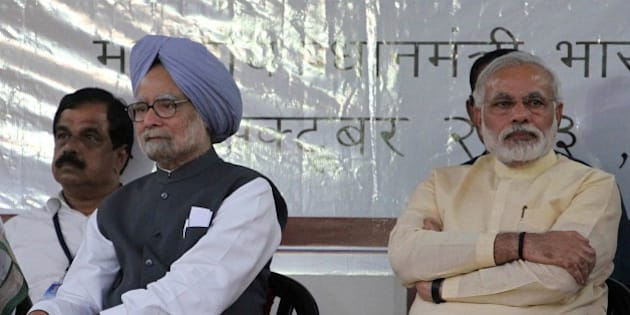 Indian Prime Minister Manmohan Singh, second left, and Gujarat state chief Minister Narendra Modi, right, attend the inauguration of the renovated memorial of Sardar Vallabhbhai Patel, one of the founding fathers of the Indian republic, in Ahmadabad, India, Tuesday, Oct. 29, 2013. Modi is the opposition Bharatiya Janata Party's (BJP) prime ministerial candidate for the 2014 general elections. (AP Photo/Ajit Solanki)