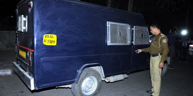 NEW DELHI, INDIA - NOVEMBER 26: A Delhi Police man stands near the van whose driver took away 22 crore rupees after halting it near Govindpuri metro station on November 26, 2015 in New Delhi, India. The driver of the cash van, which carries currencies for loading ATM machines, fled with around Rs. 22.5 crore from Govindpuri area last evening. (Photo by Sonu Mehta/Hindustan Times via Getty Images)