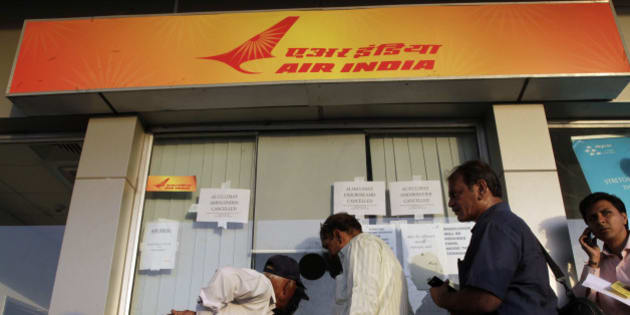 Indian passengers stand in a queue to make enquiries at an Air India counter at the airport in Ahmadabad, India, Friday, May 11, 2012. Hundreds of passengers have been stranded in India after Air India canceled around 20 international flights due to a strike by pilots. (AP Photo/Ajit Solanki)