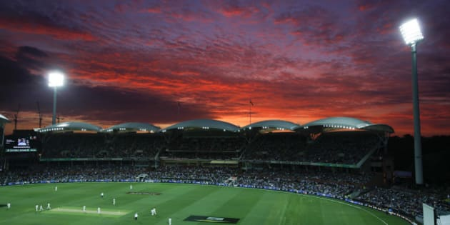 "Lights illuminate the Adelaide Oval as the sun sets during the first night session of the cricket test between Australia and New Zealand in Adelaide, Friday, Nov. 27, 2015. This match is the sport's first ever day-night test and the use of the ""experimental"" pink leather ball replacing the standard-issue red for the first time in a format that dates back to the 1870s. (AP Photo/Rick Rycroft)"