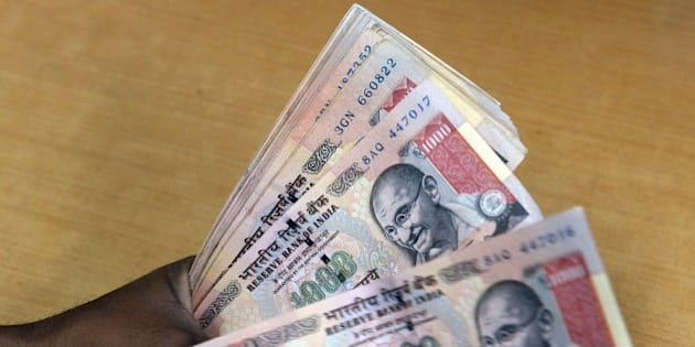 An Indian forex dealer counts INR 1000 currency notes in Mumbai on August 25, 2015. The Indian rupee recovered by 26 paise to reach 66.39 against the dollar on the Interbank Foreign Exchange in early trade. Dealers said fresh selling of the US currency by exporters and banks, the weakening of the dollar overseas and gains across stock markets supported the domestic currency.  AFP PHOTO/ INDRANIL MUKHERJEE        (Photo credit should read INDRANIL MUKHERJEE/AFP/Getty Images)