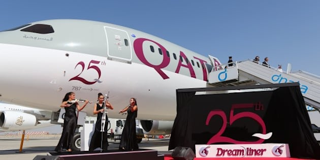 Musicians perform next to the 25th unit of Boeing 787 Dreamliner received by Qatar Airways and dislayed at the Dubai Airshow on November 9, 2015 in the Gulf Emirate. AFP PHOTO / MARWAN NAAMANI        (Photo credit should read MARWAN NAAMANI/AFP/Getty Images)