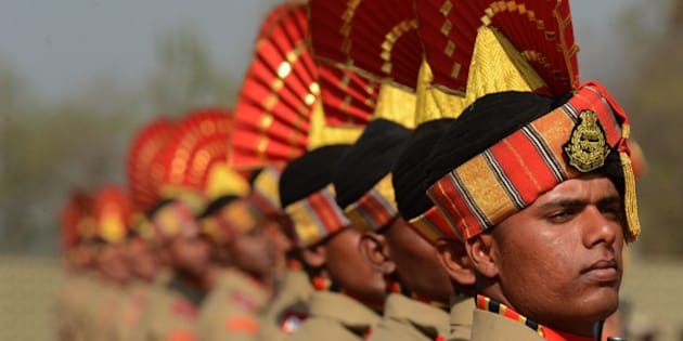 Indian Border Security Force (BSF) recruits take part in a passing out parade in Humhama on the outskirts of Srinagar on October 3, 2015. Some 338 new recruits were inducted into the force. Several groups have for decades battled hundreds of thousands of Indian troops deployed in the region, for independence or a merger of the territory with Pakistan. The conflict has left tens of thousands, mostly civilians, dead. AFP PHOTO/Tauseef MUSTAFA        (Photo credit should read TAUSEEF MUSTAFA/AFP/Getty Images)