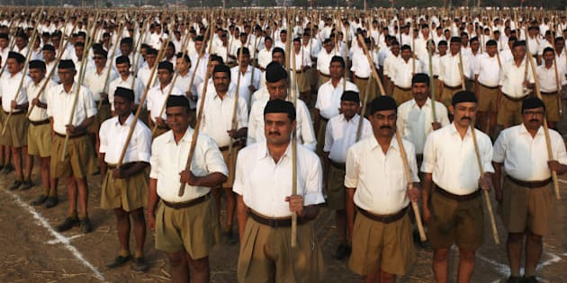 Volunteers of the militant Hindu group Rashtriya Swayamsevak Sangh (RSS) participate in a three-day workers camp on the outskirts of Ahmadabad, India, Saturday, Jan. 3, 2015. The RSS, parent organization of the ruling Bharatiya Janata Party, combines religious education with self-defense exercises. The organization has long been accused of stoking religious hatred against Muslims. (AP Photo/Ajit Solanki)