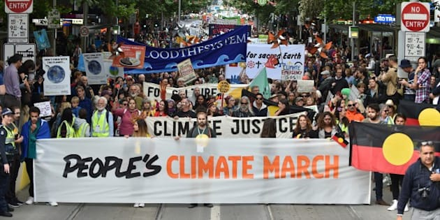 People march along a road during a rally calling for action on climate change in Melbourne on November 27, 2015. From school children to the elderly, thousands rallied in the Australian city of Melbourne on November 27 to demand action on climate change ahead of crunch talks in Paris designed to stop Earth from overheating. AFP PHOTO / Paul Crock / AFP / PAUL CROCK        (Photo credit should read PAUL CROCK/AFP/Getty Images)