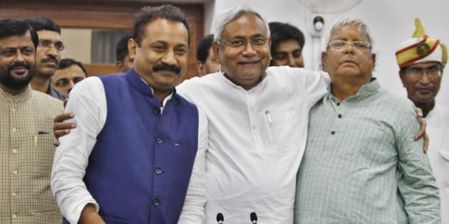 PATNA, INDIA - NOVEMBER 8: Janata Dal-United (JD-U) leader Nitish Kumar (C) and Rashtriya Janta Dal leader Lalu Prasad Yadav and Ashok Choudhary (R), President of the Bihar Pradesh Congress Committee, during a press conference after landslide victory in Bihar assembly elections at Nitish Kumar's residence, on November 8, 2015 in Patna, India. Nitish Kumar said, 'I express my gratitude towards people of Bihar, will try our best to match up with their expectations. We respect our opposition in Bihar; want to work in consensus with everyone to develop Bihar. This victory is big win and we will work towards the grand alliances mandate for the development of Bihar.' Lalu Yadav said, 'BJP had its eyes on Kolkata, the capital of West Bengal. It wanted to move eastwards. Bihar stopped them in tracks. PM Narendra Modi is nothing but an RSS pracharak.' The grand alliances victory is also attributed to the rejection of communal politics, driven mostly by the recent debate over cow slaughter and consumption of beef. Data from the election commission's website for 240 of the state's 243 seats showed the RJD-JD(U)-Congress alliance led in 178 seats, an emphatic victory over the NDA that could only win around 59 seats. (Photo by Ajay Aggarwal/Hindustan Times via Getty Images)