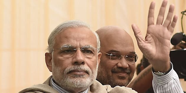NEW DELHI, INDIA - NOVEMBER 28: Prime Minister Narendra Modi and BJP President Amit Shah arrive to attend the Diwali Mangal Milan with journalists and editors at BJP headquarters, on November 28, 2015 in New Delhi, India. Modi emphasised the importance of festivals and their celebration in the nation. He asserted the celebrations were an example of India's great unity and diversity. (Photo by Mohd Zakir/Hindustan Times via Getty Images)