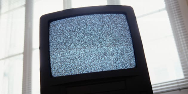 Static on television screen, back lit, low angle view