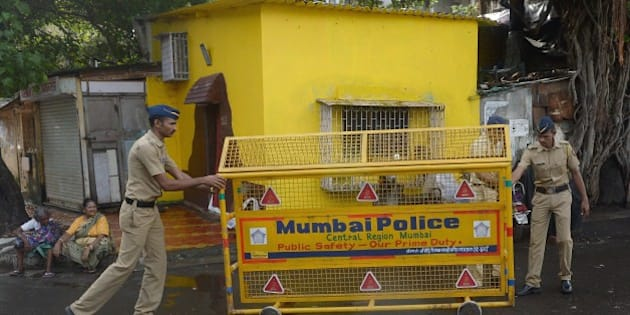 Indian policemen set up a barricade on a road in Mumbai on July 30, 2015. India executed convicted bomb plotter Yakub Memon for conspiring in the nation's deadliest attack, a series of blasts that killed hundreds in Mumbai more than two decades ago.  Memon was hanged at Nagpur jail in the western state of Maharashtra on his 53rd birthday after India's president and Supreme Court rejected 11th-hour appeals for clemency. AFP PHOTO / INDRANIL MUKHERJEE        (Photo credit should read INDRANIL MUKHERJEE/AFP/Getty Images)