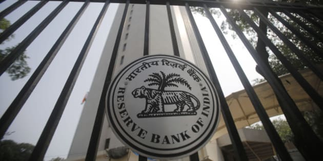 Reserve Bank of India (RBI) logo is displayed on the gate of the RBI headquarters in Mumbai, India, Tuesday, Oct 29, 2013. India's central bank raised its key interest rate for the second time in two months, underlining its determination to control inflation despite concerns economic growth could slow further. (AP Photo/Rafiq Maqbool)