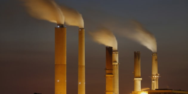 Emissions rise from stacks the Duke Energy Corp. Gibson Station power plant at dusk in Owensville, Indiana, U.S., on Thursday, July 23, 2015. Coal reclaimed its ranking as the top fuel for generating electricity at U.S. power plants in May, beating natural gas, which took the number one spot for the first time in April. Photographer: Luke Sharrett/Bloomberg via Getty Images